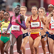 TOKYO, JAPAN August 3:  Gold medal winner Athing Mu of the United States leading at the bell from Natoya Goule of Jamaica and Chunyu Wang of China in the Women's 800m Final at the Olympic Stadium during the Tokyo 2020 Summer Olympic Games on August 3rd, 2021 in Tokyo, Japan. (Photo by Tim Clayton/Corbis via Getty Images)