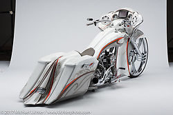 """""""Big Sexy"""", a 32 inch white and orange Road Glide bagger built by Shannon Davidson of The Chopp Shop in Taylorsville, NC. Photographed by Michael Lichter during the Easyriders Bike Show in Columbus, OH on February 10, 2017. ©2017 Michael Lichter."""