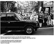 Demonstrating hotel workers outside Beverley Hills Hotel. Beverley Hills Hotel re-Opening party. Los Angeles 1995. Film 95273/4 <br />© Copyright Photograph by Dafydd Jones<br />66 Stockwell Park Rd. London SW9 0DA<br />Tel 0171 733 0108