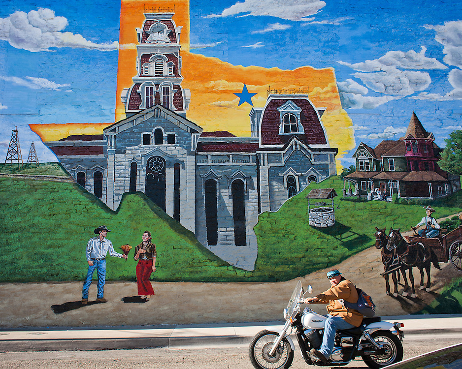 A new mural in downtown Weatherford by artist Brad Smith, commemorates local history including symbols of the Goodnight-Loving legacy.