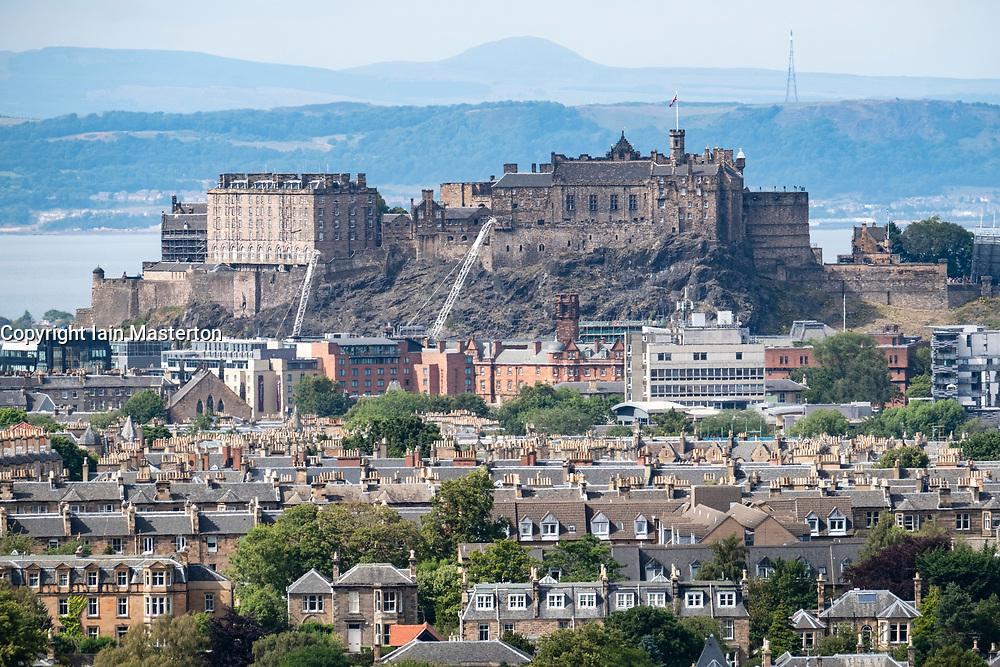 View of Edinburgh Castle across suburbs of the city from Blackford Hill , Scotland, UK