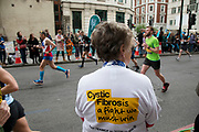 Charity Cystic Fibrosis taking part in the London Marathon on 28th April 2019 in London, England, United Kingdom. The London Marathon, presently known through sponsorship as the Virgin Money London Marathon, is a long-distance running event. The event was first run in 1981 and has been held in the spring of every year since. The race is mainly known for ebing a public race where ordinary people can challenge themsleves while raising great amounts of money for various charities.
