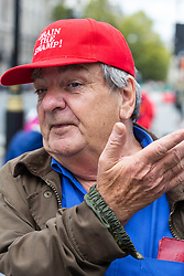 "Mike McFadden, 71, from London outside Parliament in a cap emblazoned with ""Drain the swamp!"". London, September 24 2019."