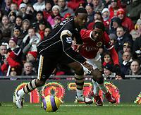 Photo: Paul Thomas.<br /> Manchester United v Charlton Athletic. The Barclays Premiership. 10/02/2007.<br /> <br /> Osei Sankofa (L) tries to stop Patrice Evraof Man Utd.