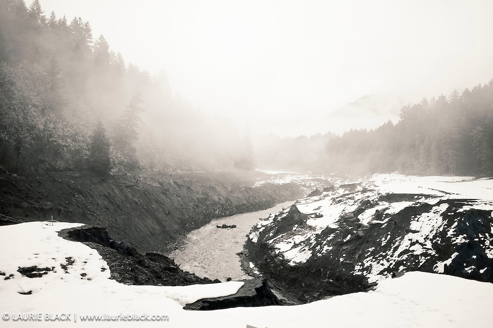 B&W photograph of newly restored White Salmon River in winter snow shortly after removal of Condit Dam