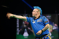 Peter Wright throws during the Premier League Darts at Marshall Arena, Milton Keynes, United Kingdom on 5 April 2021.