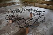 Crown of thorns sculpture at Fontfroide Abbey near Narbonne, France. Fontfroide Abbey is a former Cistercian monastery in France, situated 15 kilometers south-west of Narbonne. It was founded in 1093 by Aimery I, Viscount of Narbonne, but remained poor and obscure, and needed to be refounded by Ermengarde, Viscountess of Narbonne. The abbey fought together with Pope Innocent III against the heretical doctrine of the Cathars who lived in the region. It was dissolved in 1791 in the course of the French Revolution. The premises, which are of very great architectural interest, passed into private hands in 1908, when the artists Gustave and Madeleine Fayet dAndoque bought it to protect the fabric of the buildings from an American collector of sculpture. They restored it over a number of years and used it as a centre for artistic projects. It still remains in private hands. Today it is open to paying guests.