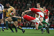 Digby Ioane of Australia breaks away from Martyn Williams and Stephen Jones. Invesco Perpetual series, Wales v Australia at the Millennium Stadium on Saturday 28th Nov 2009.  pic by Andrew Orchard, Andrew Orchard sports photography, .EDITORIAL USE ONLY