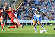 Middlesbrough midfielder Adam Clayton attempts to block a shot by Reading striker Nick Blackman during the Sky Bet Championship match between Reading and Middlesbrough at the Madejski Stadium, Reading, England on 3 October 2015. Photo by Alan Franklin.