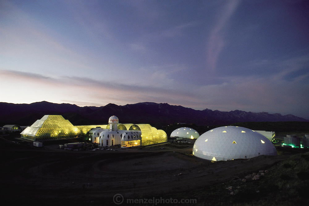 Biosphere 2 Project buildings seen at dawn near the end of the construction. The Biosphere was a privately funded experiment, designed to investigate the way in which humans interact with a small self-sufficient ecological environment, and to look at possibilities for future planetary colonization. 1991
