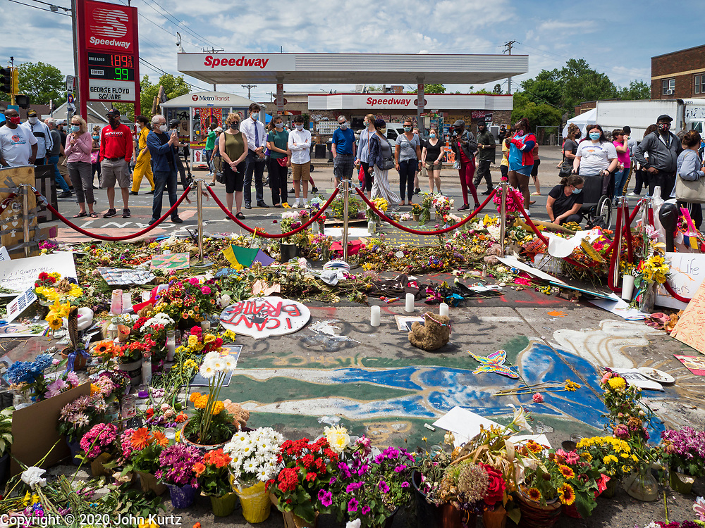 """12 JUNE 2020 - MINNEAPOLIS, MINNESOTA: The impromptu memorial for George Floyd at the corner of 38th Street and Chicago Ave. in Minneapolis. The intersection is informally known as """"George Floyd Square"""" and is considered a """"police free zone."""" There are memorials to honor Black people killed by police and people providing free food at the intersection. Floyd, an unarmed Black man, was killed by Minneapolis police on May 25 when an officer kneeled on his neck for 8 minutes and 46 seconds. Floyd's death sparked weeks of ongoing protests and uprisings against police violence around the world.          PHOTO BY JACK KURTZ"""