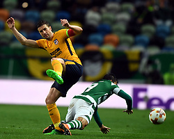 LISBON, April 13, 2018  Marcos Acuna (R) of Sporting vies with Gabi of Atletico during the Europa League quarterfinal second leg soccer match between Sporting CP and Club Atletico de Madrid at the Jose Alvalade stadium in Lisbon, Portugal, on April 12, 2018. Sporting won 1-0 but was eliminated by a 1-2 on aggregate. (Credit Image: © Zhang Liyun/Xinhua via ZUMA Wire)