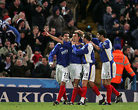 Photo: Lee Earle.<br /> Portsmouth v West Bromwich Albion. The Barclays Premiership. 17/12/2005. Portsmouth's Svetoslav Todorov (9) is congratulated after scoring their opening goal.