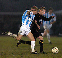 Photo: Alan Crowhurst. Brighton v Wigan, Coca-Cola Championship, 15/03/2005. Gary Teale R holds off Daniel Harding for the ball.