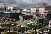 An aerial landscape of Westfield City shopping centre (right), Stratford rail station hub (c) and the Olympic Park venues to the left. Home and arrival point during the London 2012 Olympics, the 30th Olympiad. The foreground artwork called 'The Shoal' is made up of around 100 titanium clad 'leaves' mounted between 15 and 19 metres high on metal posts. Worth £13.5m, the Shoal is part of The Stratford Town Centre Public Realm Project, designed and manufacturered using 3D technology. Westfield is Europe's largest urban shopping centre. The station is served by the National Rail services National Express East Anglia, London Overground and c2c, by London Underground's Central and Jubilee lines, and by the Docklands Light Railway (DLR). Stratford is in London Travelcard Zone 3, and Network Rail owns the station.