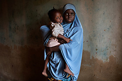 Dada, 14, escaped with her child, born of a Boko Haram fighter, about one year ago. Boko Haram, a militant Islamist group, began it's insurgency against the Nigerian government in 2009. The terrorist group drew global outrage after abducting more than 270 schoolgirls from the town of Chibok. Many of the girls were forced into marriage and motherhood. The Borno State National Emergency Agency estimates tens of thousands more women and girls have also been kidnapped by militants in less-publicized attacks. In armed conflicts, child marriage is increasingly used as a weapon of war, forcing girls to give birth give birth to the next germination of fighters. Thousands of girls remain missing in Nigeria with little help of rescue. Those who manage to escape struggle with little support to rebuild their lives.