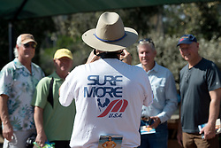 October 13, 2016 - Dana Point, California, USA - Wearing a Surfmore shirt, Tracy Sizemore takes a picture of high school friends of Robert Nealy before the start of his memorial service at Dohney State Beach in Dana Point, California, October 13, 2016...Friends and family gathered for a memorial for Nearly who is credited with inventing the Velco surf leach in 1973...Nealy lost a long battle with lymphoma on September 1, 2016...(Photo by Jeff Gritchen, Orange County Register/SCNG) (Credit Image: © Jeff Gritchen/The Orange County Register via ZUMA Wire)