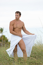hot man on the beach in a towel