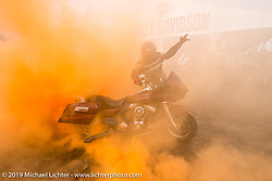 Stunt riders perform at the Harley-Davidson display during the Annual Sturgis Black Hills Motorcycle Rally. SD, USA. August 8, 2014.  Photography ©2014 Michael Lichter