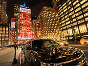The Helmsley Building lit up in orange and blue colors in Manhattan, New York City.