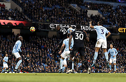 West Ham United's Angelo Ogbonna (centre) scores his side's first goal of the game during the Premier League match at the Etihad Stadium, Manchester.