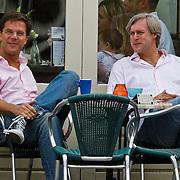 NLD/Amsterdam/20100822 - VVD fractieleider Mark Rutte geniet van een vrije zondag op een terras in Amsterdam met een vriend