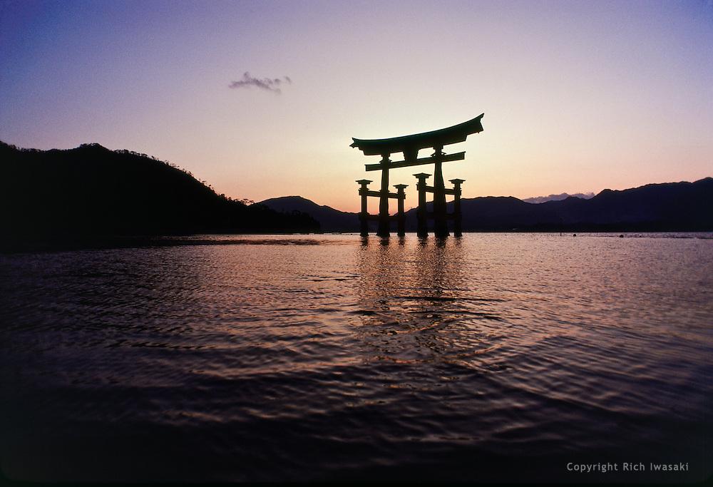 Grand torii (gateway) of Itsukushima-jinja (shrine) at sunset, Miyajima island, Hiroshima Prefecture, Japan