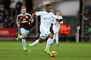 Jordan Ayew of Swansea city in action. Premier league match, Swansea city v Burnley at the Liberty Stadium in Swansea, South Wales on Saturday 4th March 2017.<br /> pic by Andrew Orchard, Andrew Orchard sports photography.