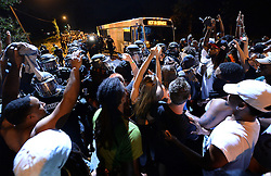 Charlotte-Mecklenburg police officers in riot gear form a line as protestors fill Old Concord Rd. on Tuesday night, Sept. 20, 2016 in Charlotte, N.C. The protest began on Old Concord Road at Bonnie Lane, where a Charlotte-Mecklenburg police officer fatally shot a man in the parking lot of The Village at College Downs apartment complex Tuesday afternoon. The man who died was identified late Tuesday as Keith Scott, 43, and the officer who fired the fatal shot was CMPD Officer Brentley Vinson. Photo by Jeff Siner/Charlotte Observer/TNS/ABACAPRESS.COM