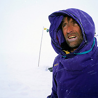 ANTARCTICA, Queen Maud Land. Michael Graber (MR) waits out a storm and whiteout in base camp for a big wall climbing expedition to the Filchner Mountains. Tibetan Buddhist prayer flags hang in background