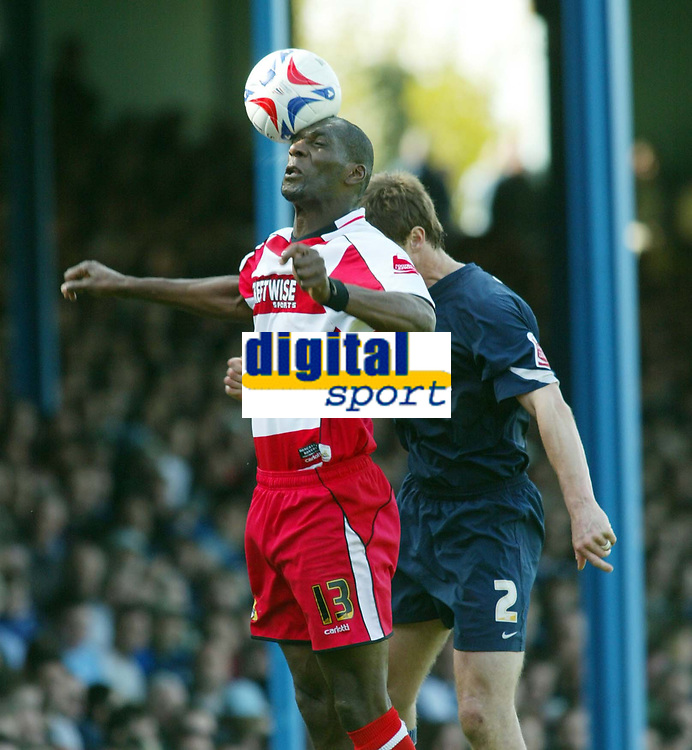 Photo: Chris Ratcliffe.<br />Southend United v Doncaster Rovers. Coca Cola League 1. 22/04/2006.<br />Duncan Jupp (R) of Southend is beaten to the ball by Leo Fortune-West of Doncaster