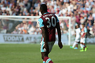 Michail Antonio of West Ham United clutches his hamstring. Premier league match, West Ham Utd v Swansea city at the London Stadium, Queen Elizabeth Olympic Park in London on Saturday 8th April 2017.<br /> pic by Steffan Bowen, Andrew Orchard sports photography.