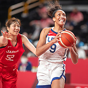 TOKYO, JAPAN August 8:  A'ja Wilson #9 of the United States drives rot the basket defended by Yuki Miyazawa #52 of Japan during the Japan V USA basket final for women at the Saitama Super Arena during the Tokyo 2020 Summer Olympic Games on August 8, 2021 in Tokyo, Japan. (Photo by Tim Clayton/Corbis via Getty Images)