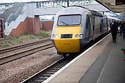 East Coast mainline train at platform, Peterborough station, England