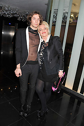 TOMAS AUKSAS and AMANDA ELIASCH at W London - Leicester Square for the Liberatum Cultural Honour in Spice Market for John Hurt, CBE in association with artist Svetlana K-Lié on 10th April 2013.