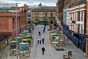 A view of Station Street taken from the tramway in Nottingham, Nottinghamshire, United Kingdom. The city centre was pedestrianised to make the air cleaner and make more people use public transport.