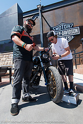 Jesse Rooke with MC Dano at the Harley-Davidson Rally Point Plaza during the Annual Sturgis Black Hills Motorcycle Rally.  SD, USA.  August 7, 2016.  Photography ©2016 Michael Lichter.