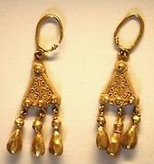 Pair of gold earrings.