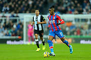 Wilfried Zaha (#11) of Crystal Palace on the ball during the Premier League match between Newcastle United and Crystal Palace at St. James's Park, Newcastle, England on 21 December 2019.