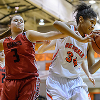 Gallup Bengal Ni'Asia McIntosh (34) pulls the ball away from Grants Pirates Devyn Griego (3) Friday at Gallup High School.