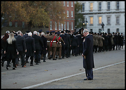 November 13, 2016 - London, United Kingdom - Image ©Licensed to i-Images Picture Agency. 13/11/2016. London, United Kingdom. Prince Charles Remembrance Sunday. ..The Prince of Wales doffs his hat to members of the Welsh Guard parading past, after he laid a wreath at the Guard's Memorial for the Welsh Guards' Regimental Remembrance Sunday, Horse Guards Road, London...Picture by i-Images / Pool (Credit Image: © i-Images via ZUMA Wire)