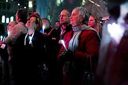 © Licensed to London News Pictures. 22/07/2014.  Members of the public hold candles to mourn the victims of HIV/AIDS and the victims of flight MH17 during a candlelight vigil at Federation Square in Melbourne, Australia. At least six delegates travelling to the 20th International AIDS Conference were on board the Malaysia Airlines flight MH17. Photo credit : Asanka Brendon Ratnayake/LNP