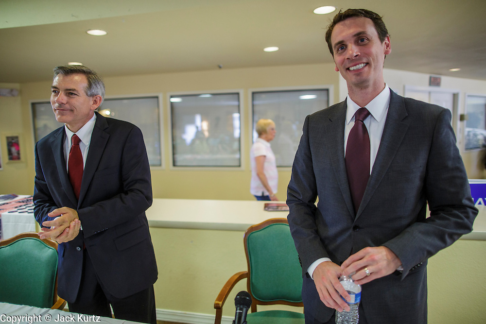09 AUGUST 2012 - SCOTTSDALE, AZ:  Congressmen DAVID SCHWEIKERT (R-AZ), left, and BEN QUAYLE (R-AZ) after a candidate forum at an adult assisted living facility in Scottsdale, AZ, Thursday. Republican Congressmen Ben Quayle and David Schweikert are facing each other in Arizona's Aug. 28 Republican primary. They are vying for the right to represent Arizona's 6th Congressional District. Both men are incumbent freshmen Congressmen. They were thrown into the same district during the redistricting process after the 2010 census. Both men are conservatives courting the Tea Party vote.   PHOTO BY JACK KURTZ