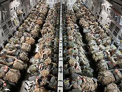 Members of the Army's 1st Battalion, 503rd Infantry Regiment, 173rd Airborne Brigade and the Italian Army's 186th Airborne Regiment, Forlgore Brigade board a C-17 Globemaster III during exercise Bayonet Strike June 13, 2018, at Aviano Air Base, Italy. (U.S. Air National Guard photo by Senior Airman John Linzmeier)