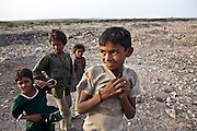 Children play in the local dumping area know as the Bhistra district of Bhavnagar, Gujarati State. The Shaishav Trust is trying to provide education and support for children in child labour.