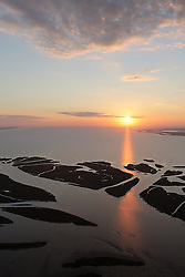 Matagorda Bay diversion channel at the mouth of the Colorado River, Texas at sunset,