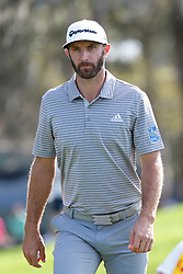 March 14, 2019 - Ponte Vedra Beach, FL, U.S. - PONTE VEDRA BEACH, FL - MARCH 14: Dustin Johnson of the United States looks on from the 15th hole during the first round of THE PLAYERS Championship on March 14, 2019 on the Stadium Course at TPC Sawgrass in Ponte Vedra Beach, Fl. (Photo by David Rosenblum/Icon Sportswire) (Credit Image: © David Rosenblum/Icon SMI via ZUMA Press)