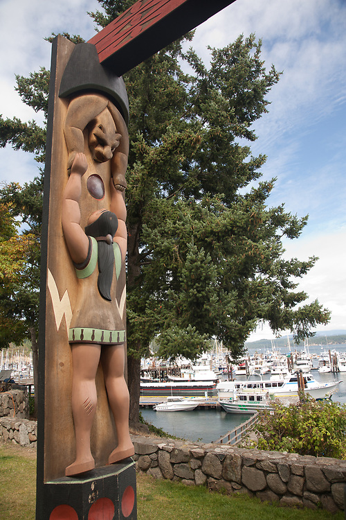 United States, Washington, San Juan Island, Friday Harbor. Native American totem pole at the Port of Friday Harbor.
