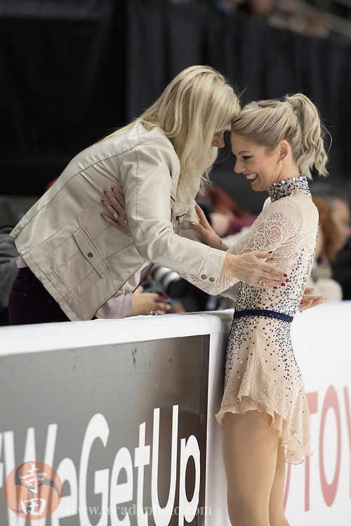 January 4, 2018; San Jose, CA, USA; Alexa Scimeca-Knierim (right) hugs mother Tina Scimeca (left) after skating in the pairs short program during the 2018 U.S. Figure Skating Championships at SAP Center.