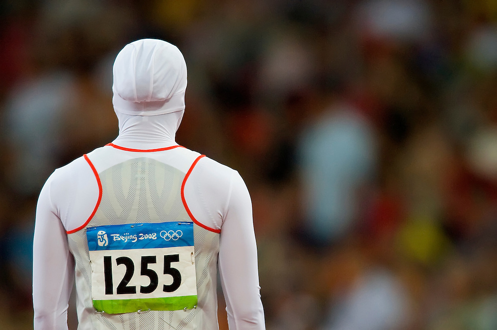 Roqaya Al-Gassra of Bahrain ran in a track suit that kept her head covered at National Stadium on August 19, 2008 during the 2008 Summer Olympic Games in Beijing, China. (photo by David Eulitt / MCT)